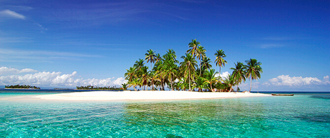 island in san blas with palm trees and white sand beach